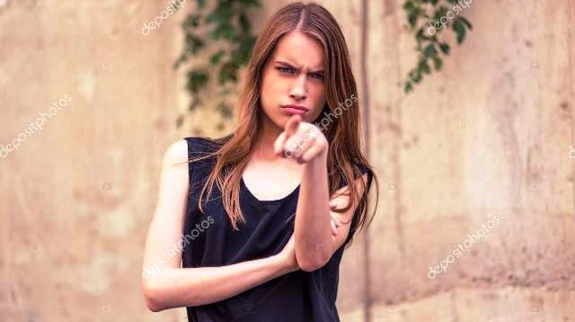 Angry young woman angry expression (depositphotos)