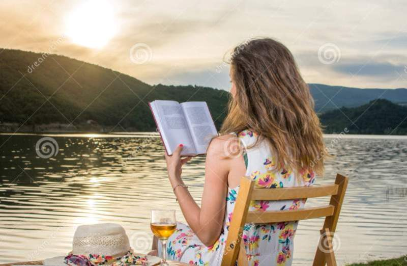 woman reading book-(Photo Credited Dreamstimes)